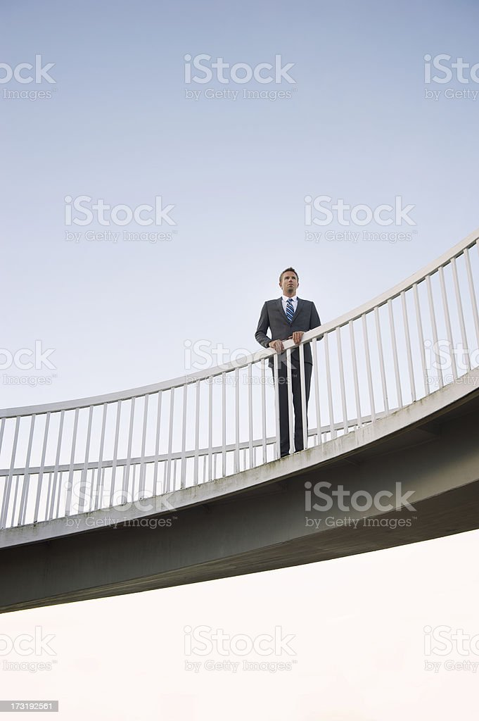 Businessman Standing on Sky Ramp royalty-free stock photo