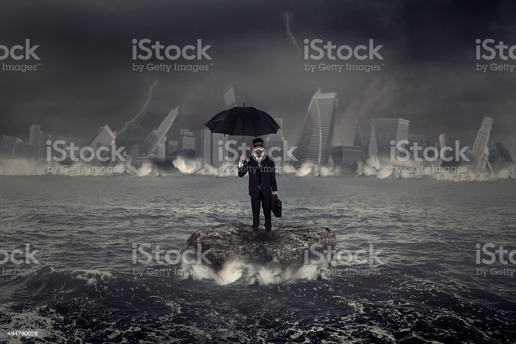 Businessman standing on the sea with crisis storm stock photo