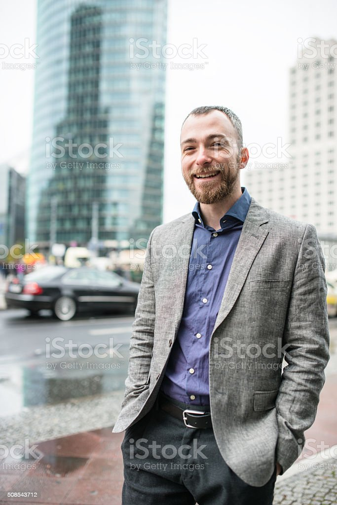 businessman standing on the street of berlin stock photo