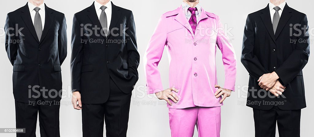 Businessman Standing Out From the Crowd stock photo