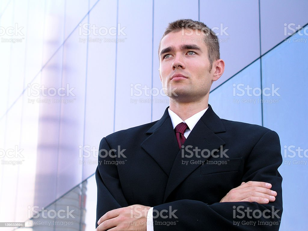 Businessman Standing Outside a Modern Office Building royalty-free stock photo