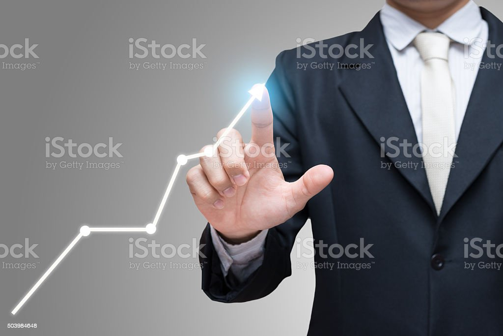 Businessman standing posture hand touch graph finance stock photo