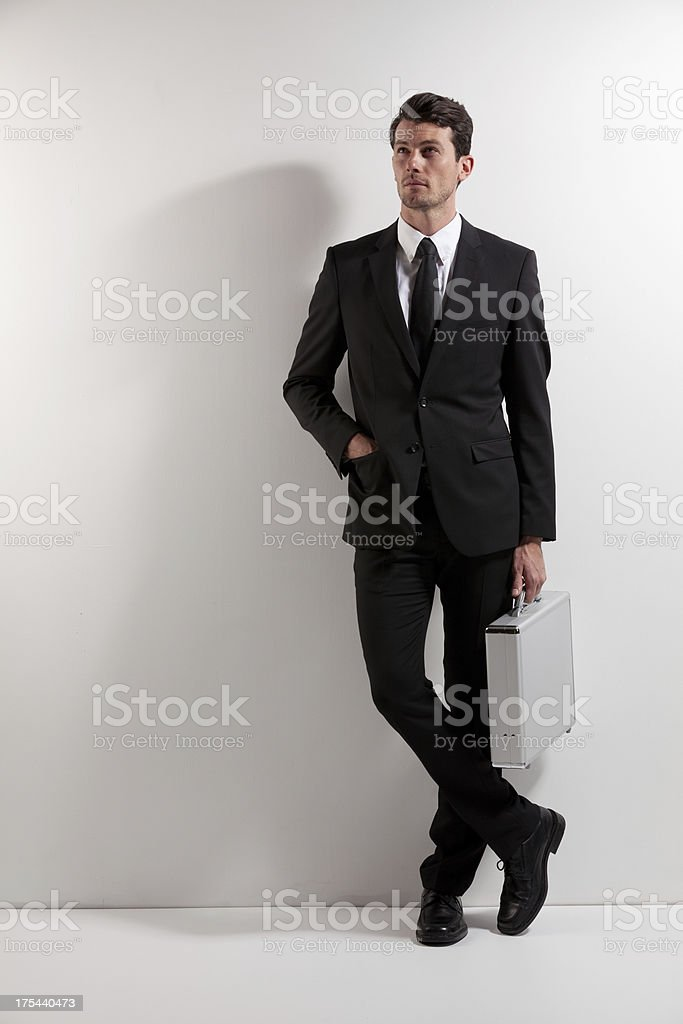 Businessman standing with a briefcase royalty-free stock photo