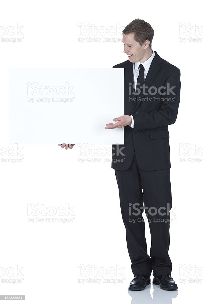 Businessman standing with a placard royalty-free stock photo