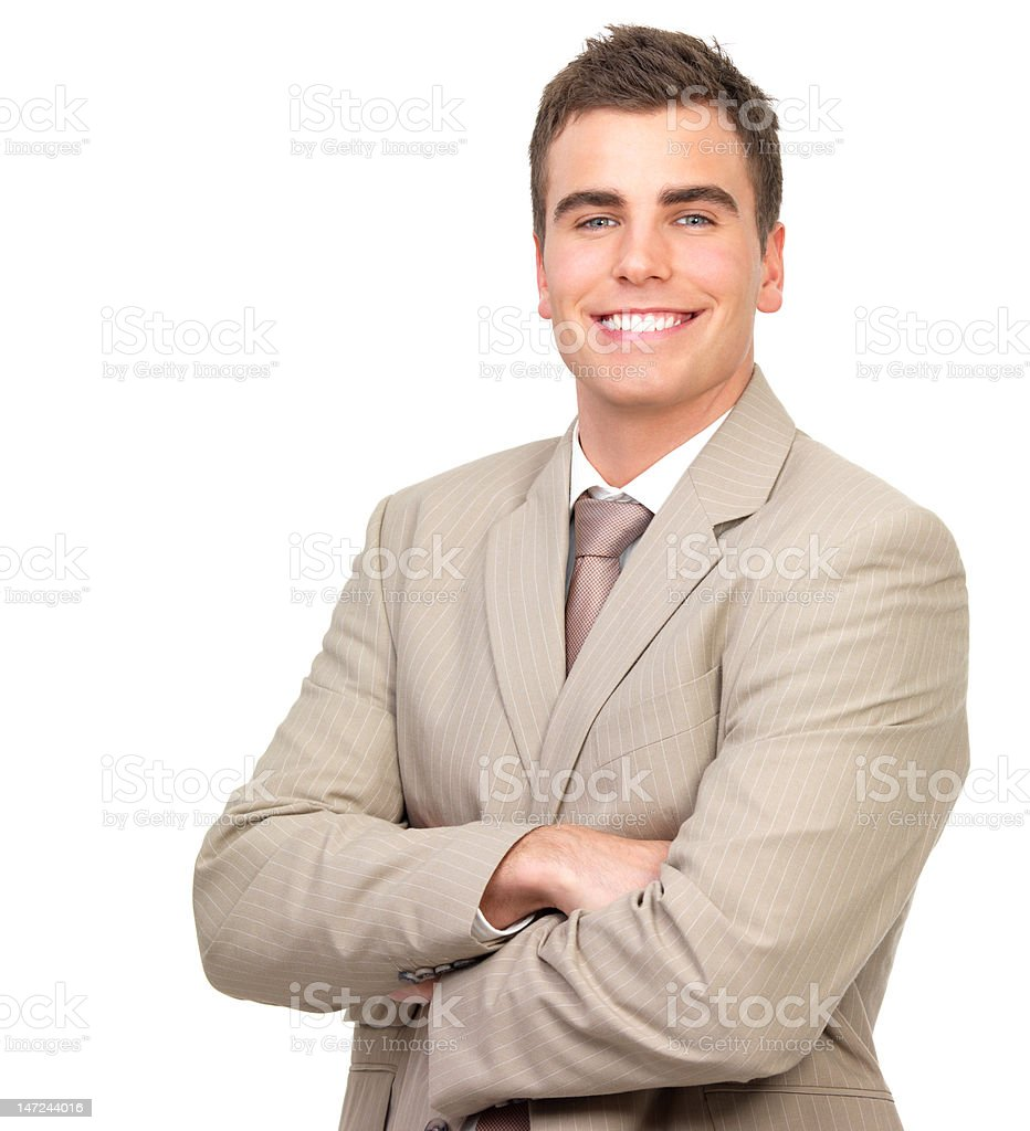 Businessman standing with arms crossed and smiling against white background royalty-free stock photo