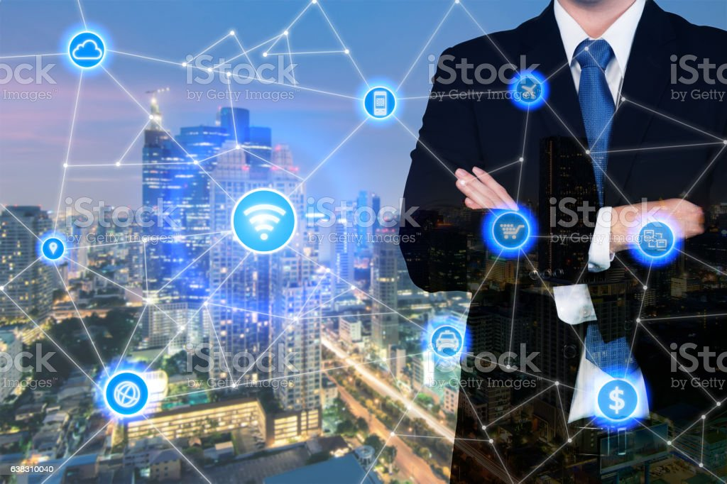 businessman standing with arms crossed with technology and communication icon. stock photo