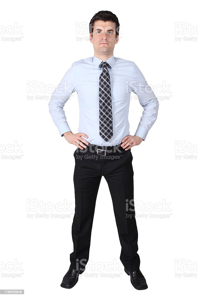 Businessman standing with hands on hips stock photo