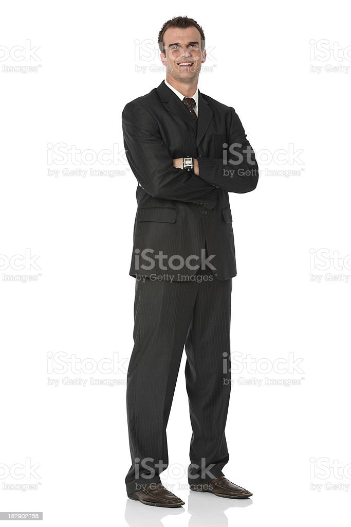 Businessman standing with his arms crossed and smiling royalty-free stock photo