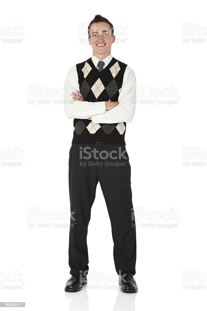 Businessman standing with his arms crossed and smiling stock photo