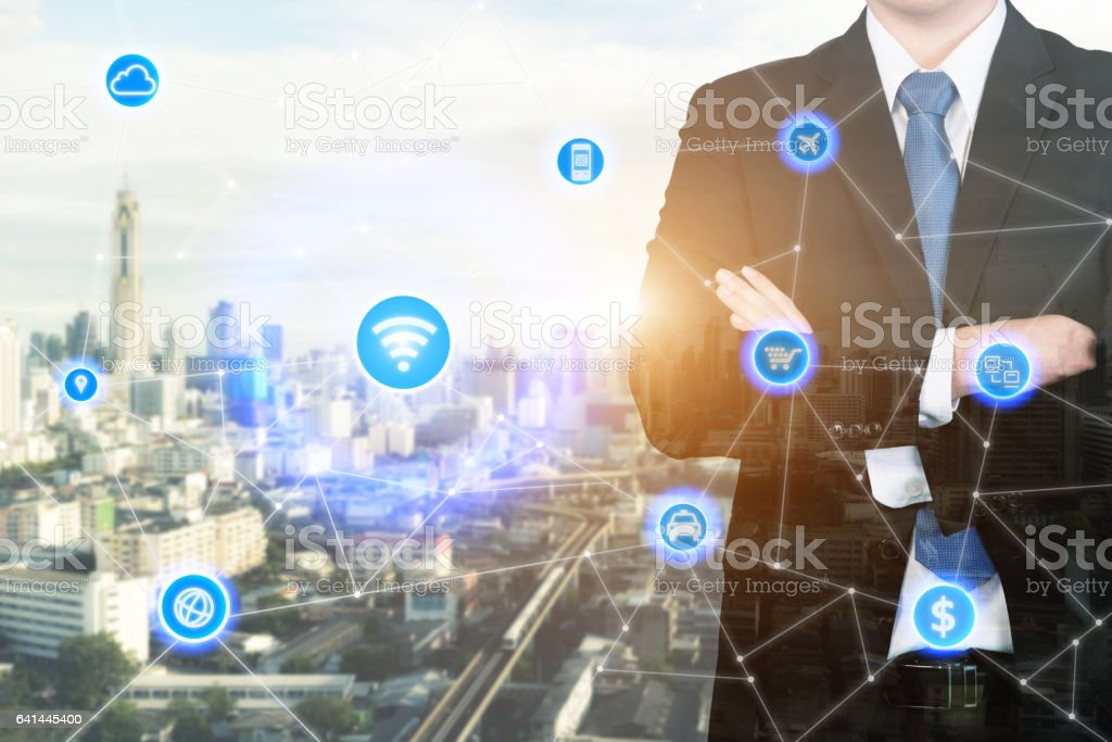businessman standing with his arms crossed with technology icon stock photo