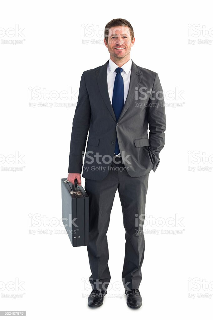 Businessman standing with his briefcase stock photo