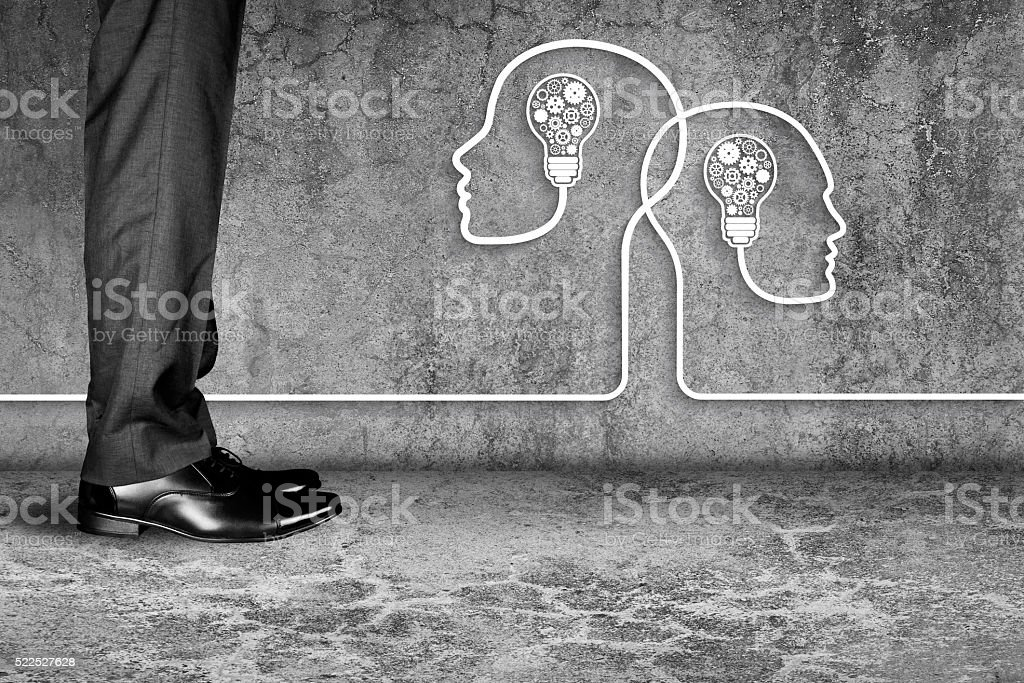 Businessman standing with human heads and light bulbs stock photo