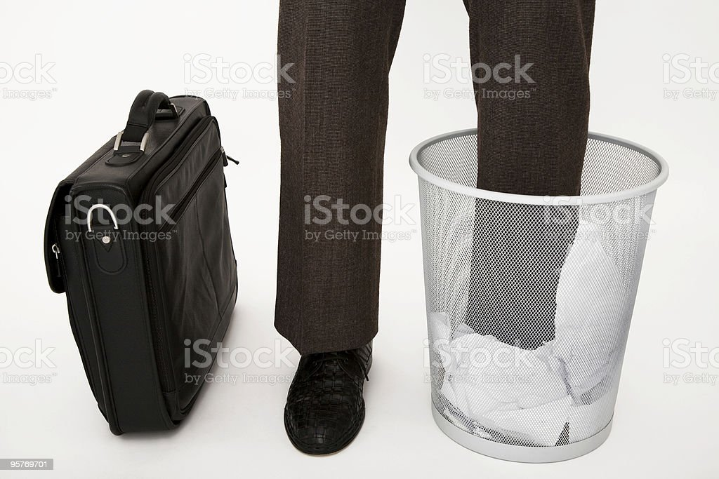 Businessman Standing with One Leg in Wastepaper Basket royalty-free stock photo