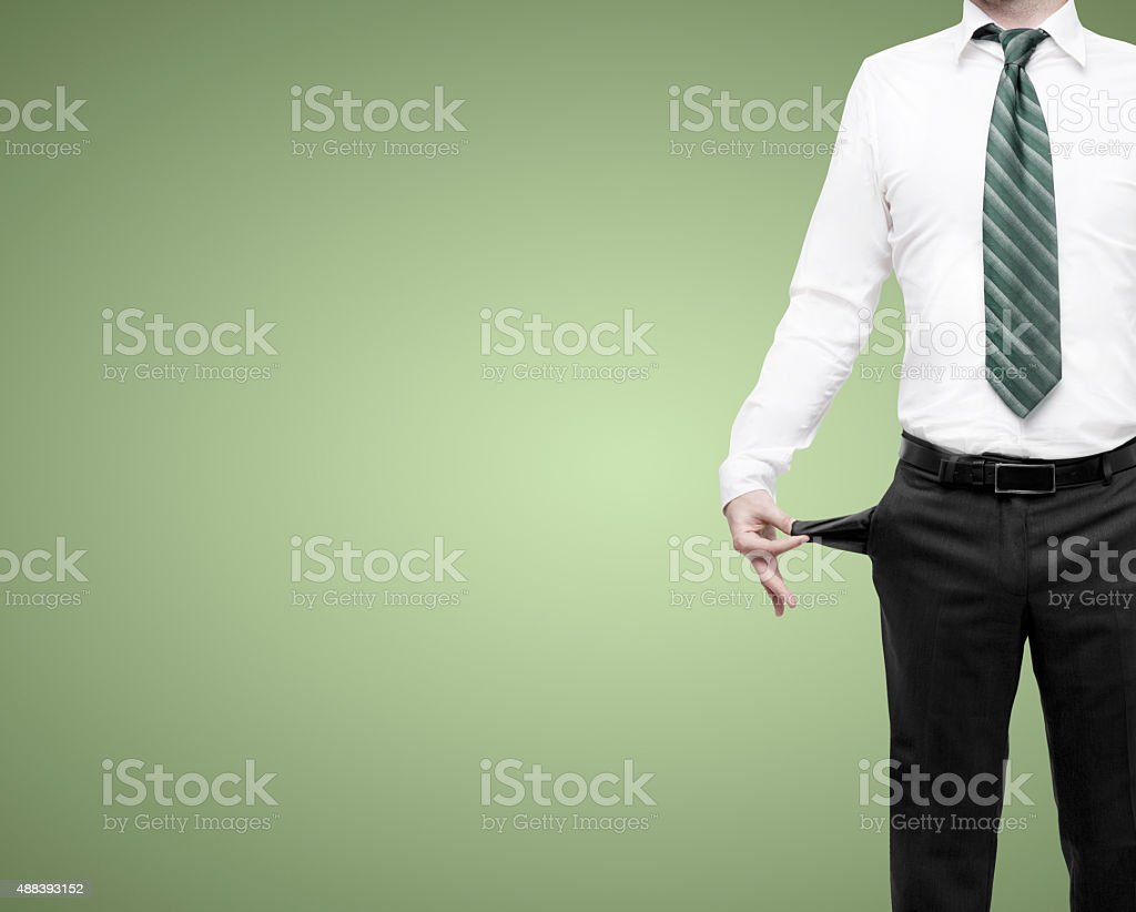 businessman standing with pockets turned inside out stock photo