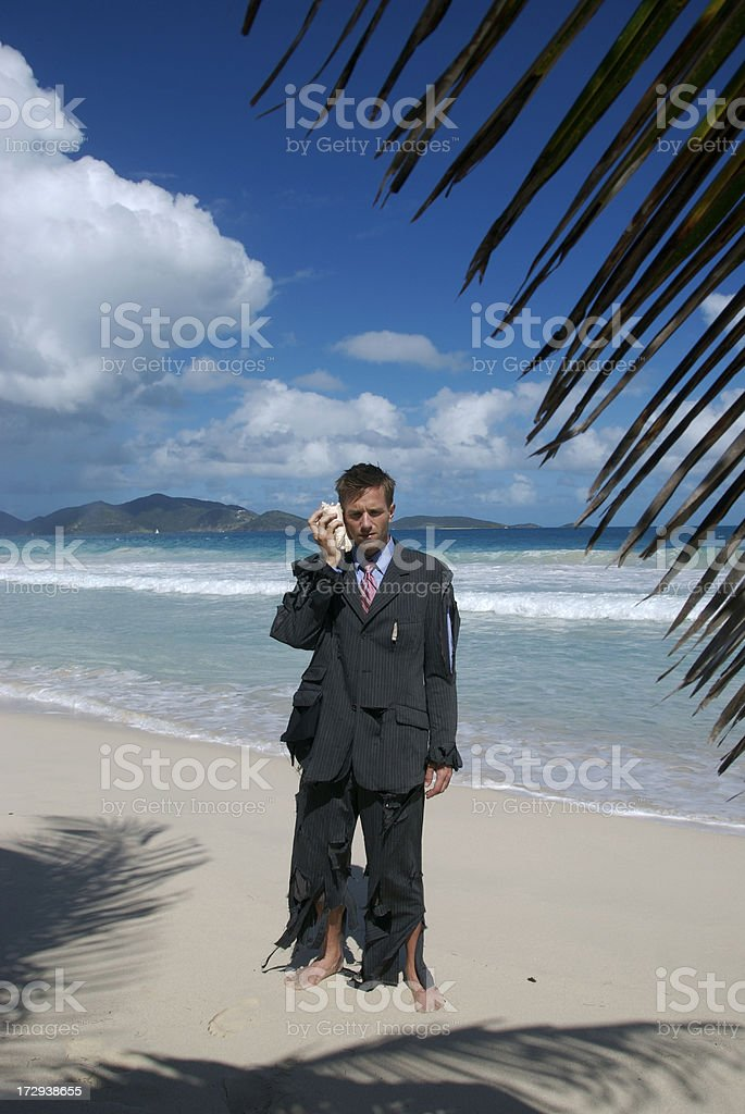 Businessman Stands Tropical Beach Talking on Shellphone royalty-free stock photo