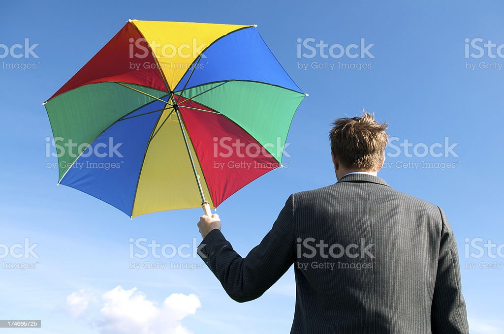 Businessman Stands w Colorful Umbrella royalty-free stock photo