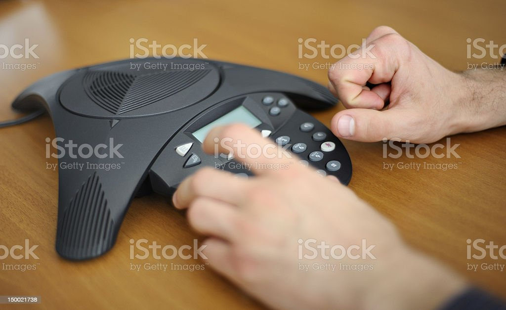 Businessman starting a conference call stock photo