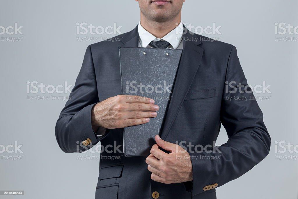 Businessman Stealing Files stock photo