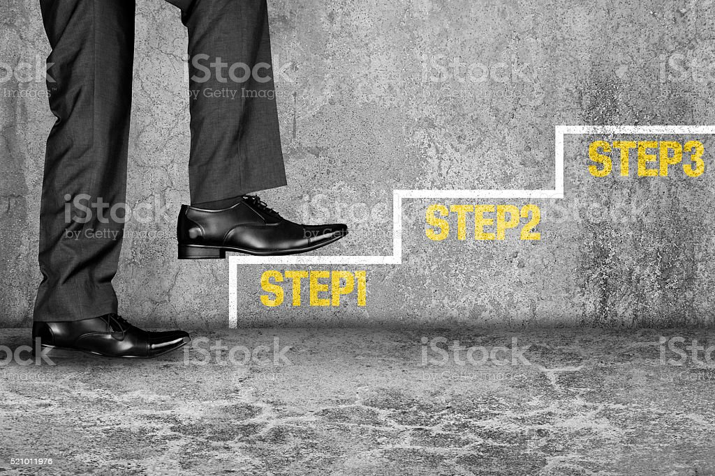 Businessman stepping on his first step stock photo
