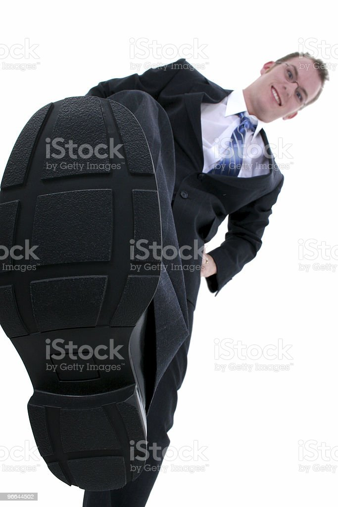 Businessman Stomping Out The Competition stock photo