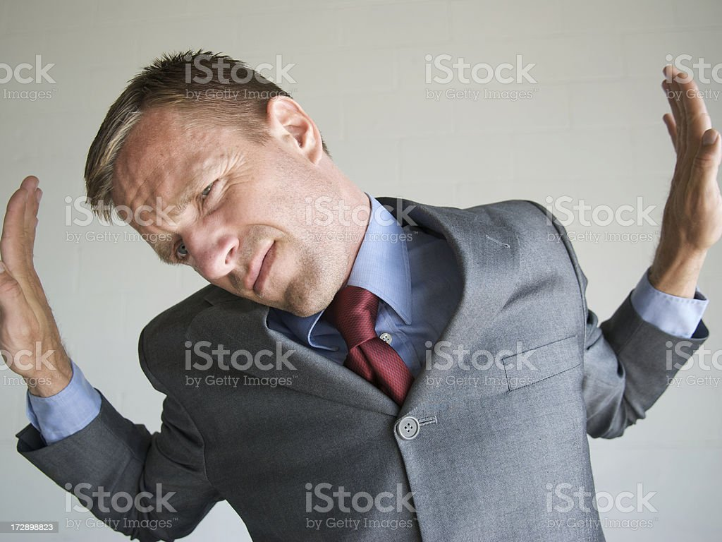 Businessman Strains Against the Walls of His Box Frame stock photo