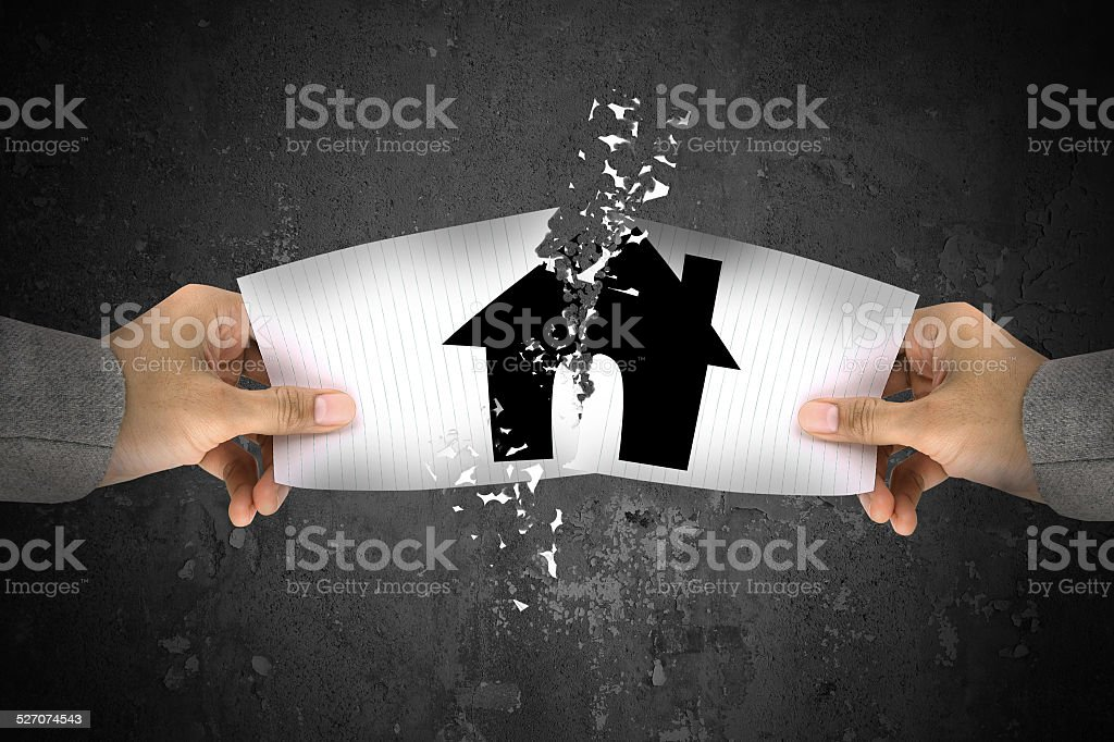 Businessman stress, ripping up a house paper stock photo