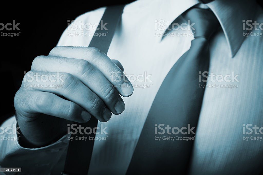 Businessman Stretching His Suspenders, Black and White royalty-free stock photo