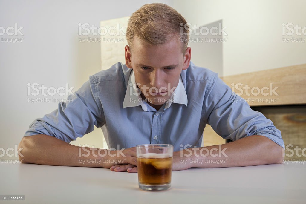 Businessman struggling with alcoholic problem stock photo