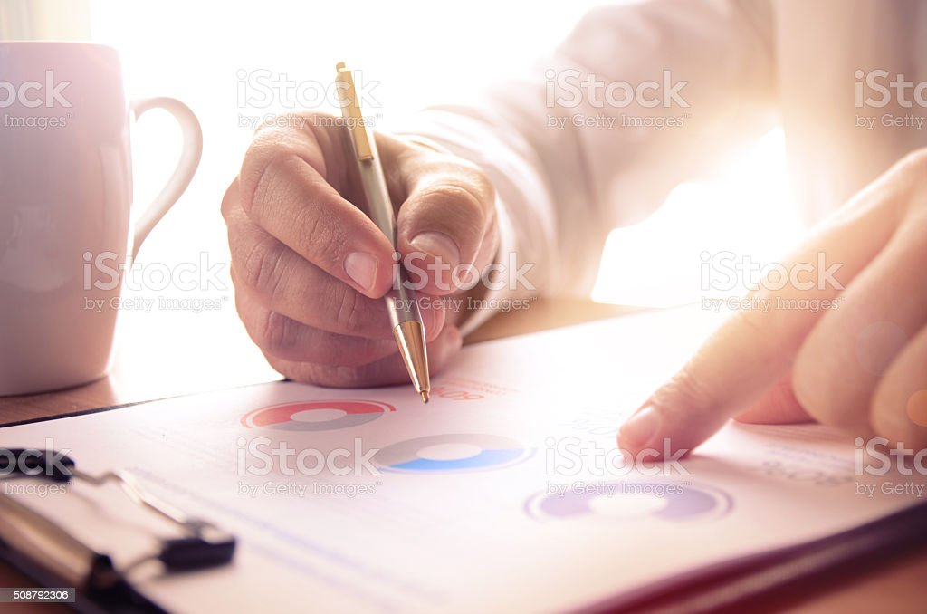Businessman study financial report stock photo