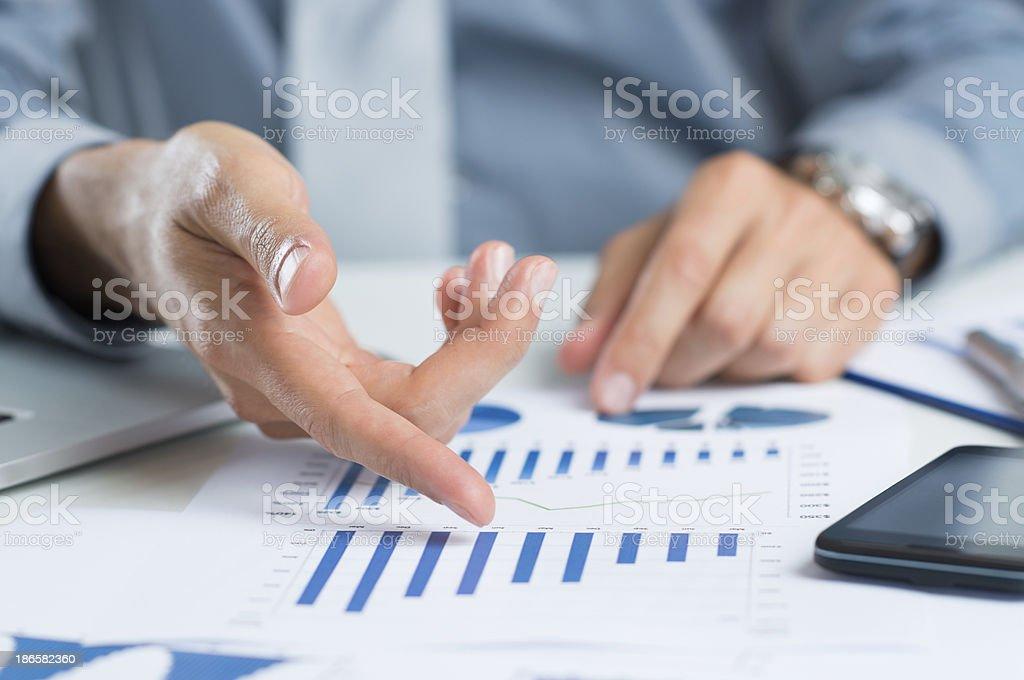 Businessman Studying Graph stock photo