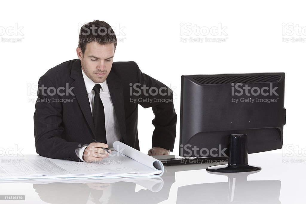 Businessman studying reports at desk royalty-free stock photo
