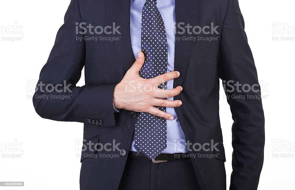 Businessman suffering from heartburn. royalty-free stock photo