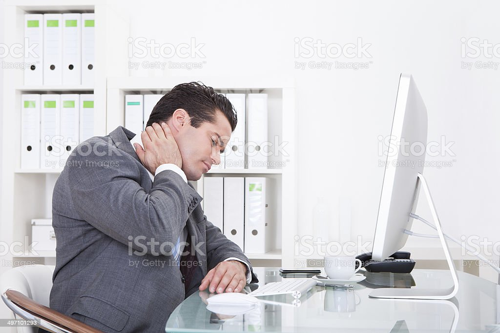 Businessman Suffering From Neck Pain stock photo