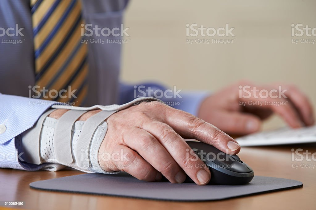 Businessman Suffering From Repetitive Strain Injury (RSI) stock photo