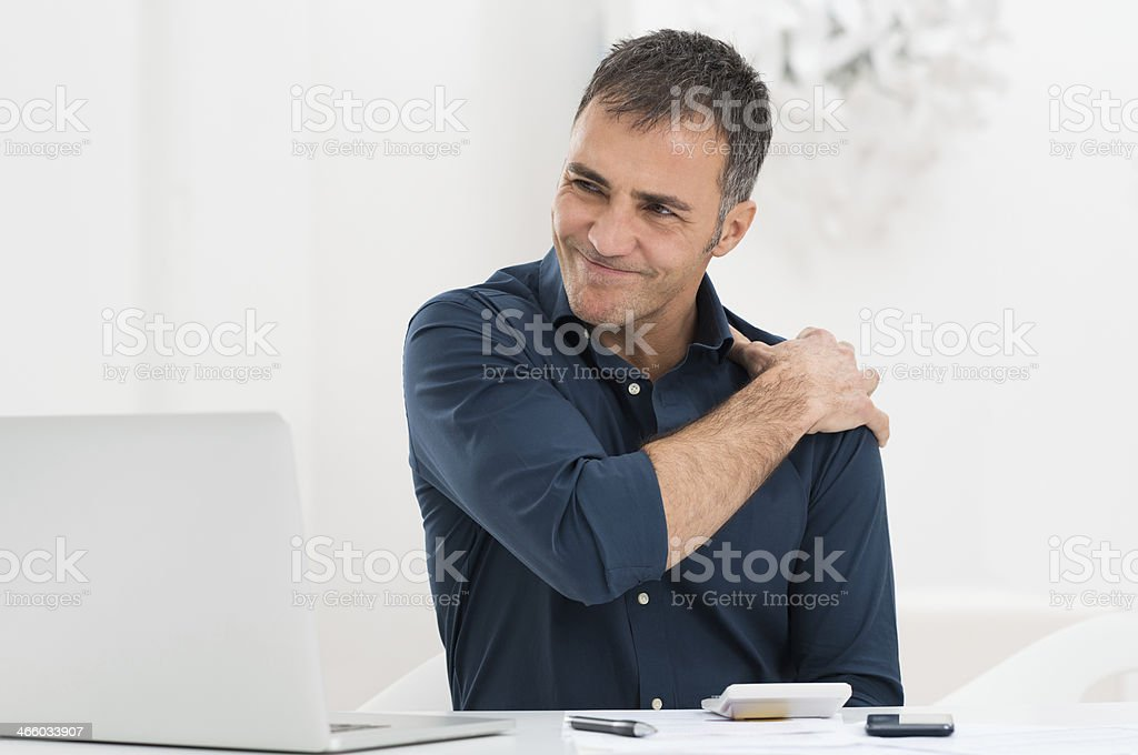 Businessman Suffering From Shoulder Pain stock photo