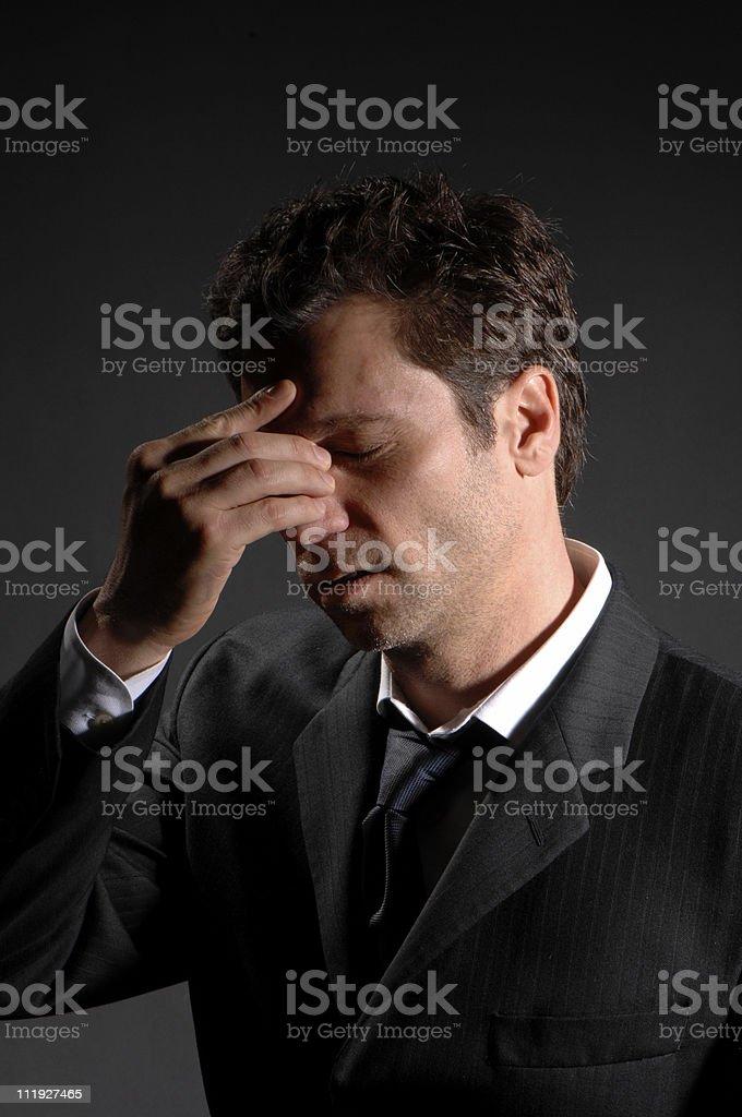 Businessman Suffering Sinus Headache on Black royalty-free stock photo