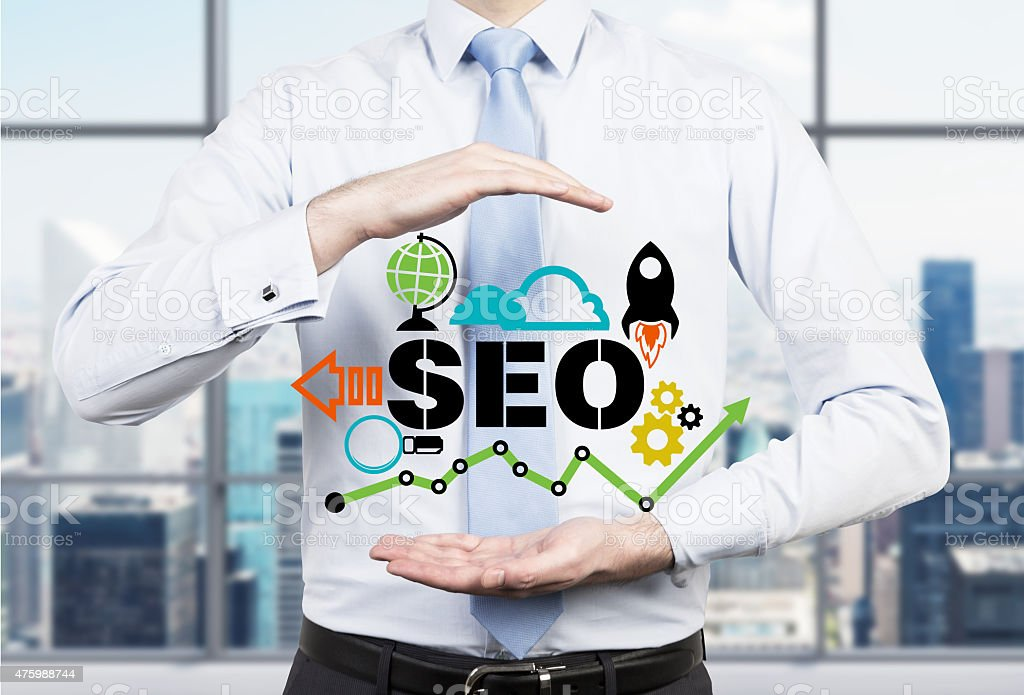 Businessman suggested effective 'SEO' optimisation approach. stock photo