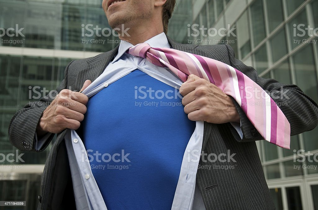 Businessman Superhero with Blue T-Shirt Standing Outside Office Building stock photo