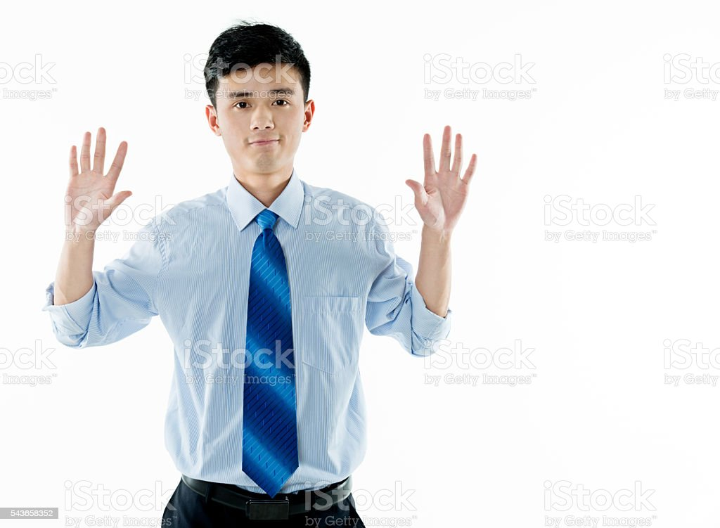 Businessman surrender with hands up stock photo