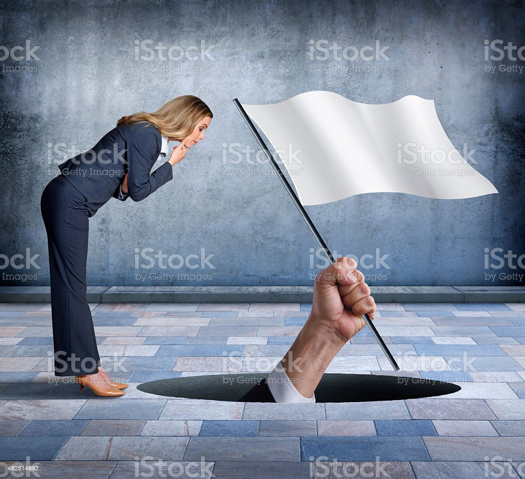 Businessman Surrendering to Businesswoman stock photo