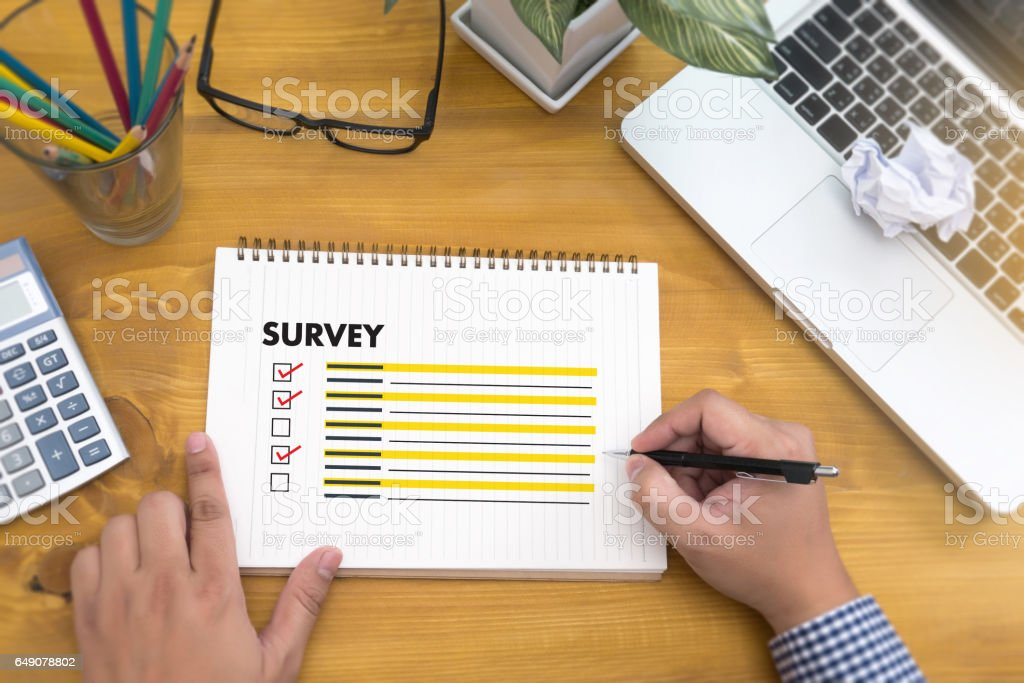 businessman  SURVEY and  Results Analysis Discovery Concept stock photo