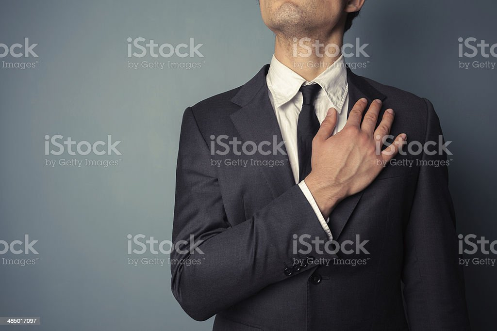 Businessman swearing allegiance stock photo