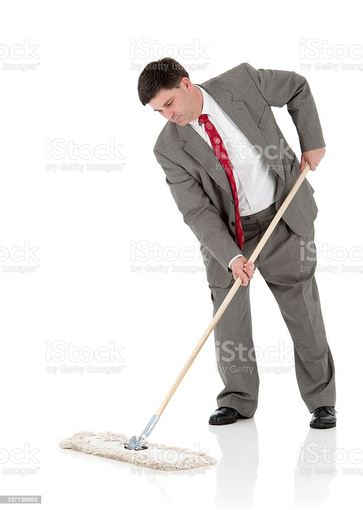 Businessman Sweeping Up The Floor (Isolated, XXXL) stock photo