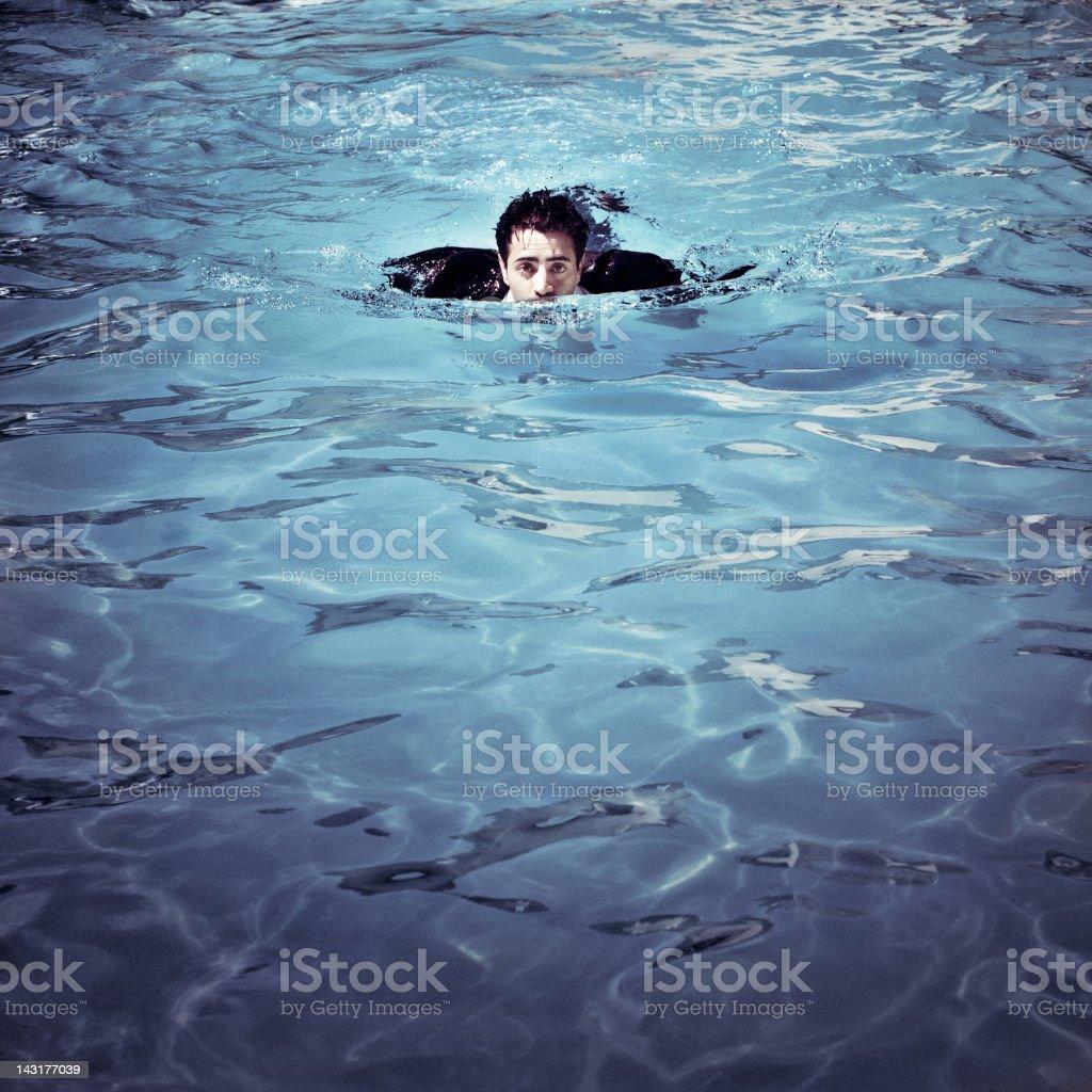 Businessman swimming stock photo