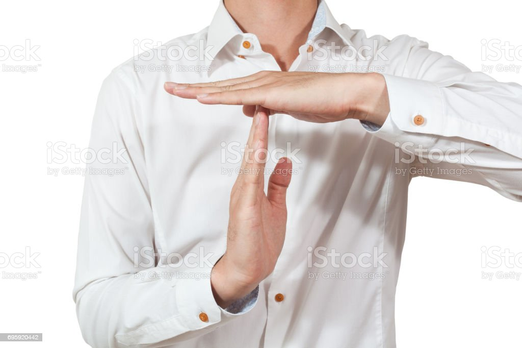 businessman take a gesture of timeout on white backgrounds, isolated stock photo