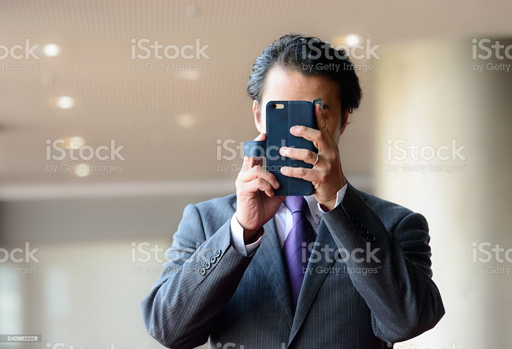 businessman takes a picture or selfie stock photo
