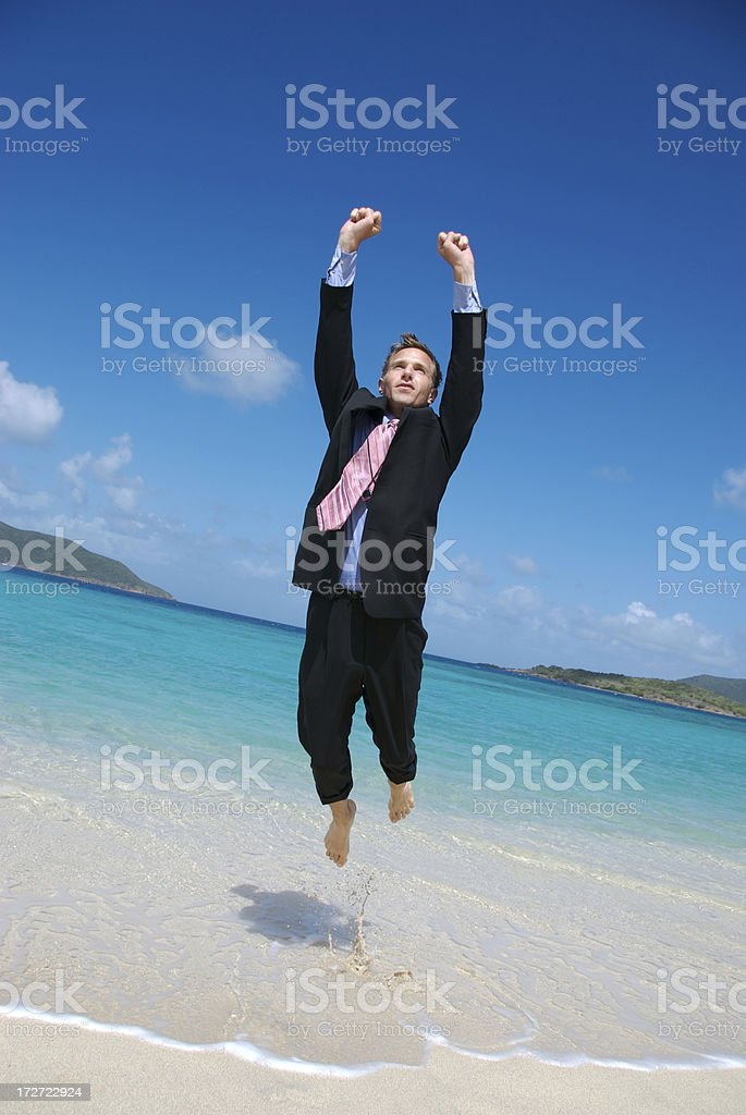 Businessman Takes off from Tropical Beach royalty-free stock photo