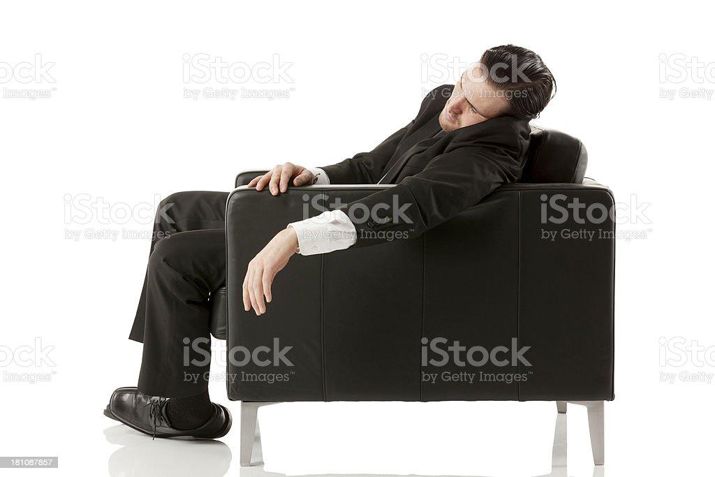 Businessman taking a nap stock photo