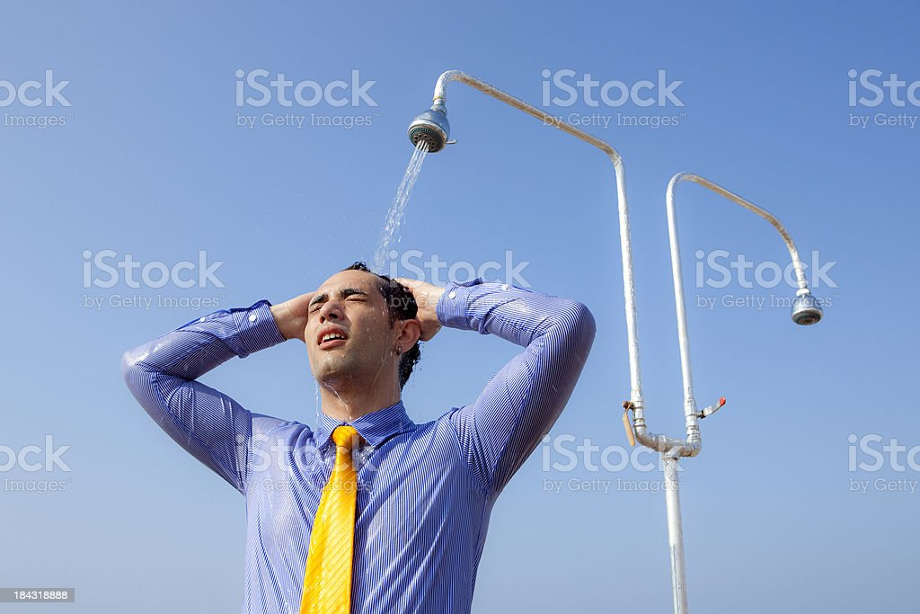 Businessman taking a shower royalty-free stock photo