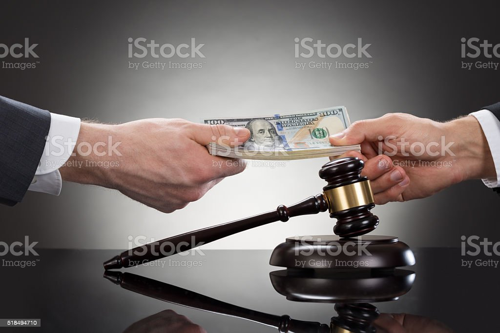 Businessman Taking Bribe In Front Of Mallet stock photo